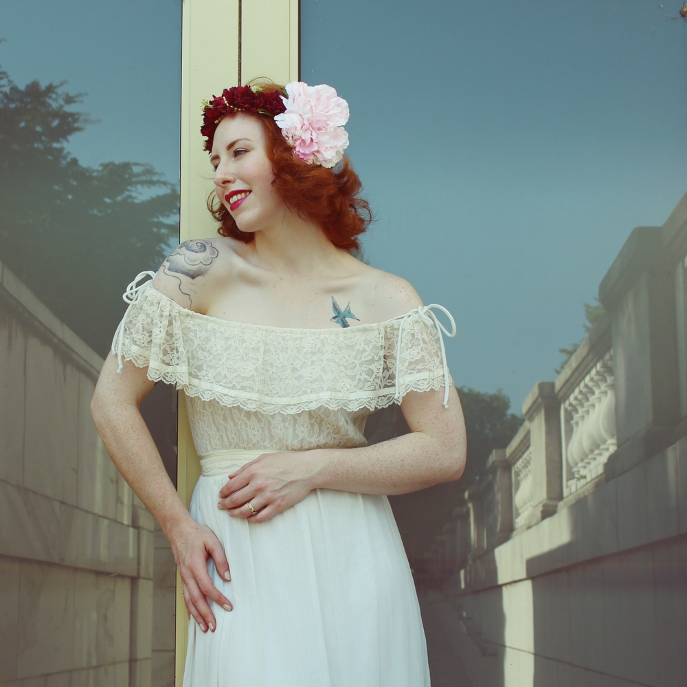 Zella Maybe in an Edwardian inspired dress from Gunne Sax and floral headdress.