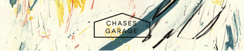 Pulled from an email blast about the show from Chase's Garage; Their logo looking good in front of one of my prints!