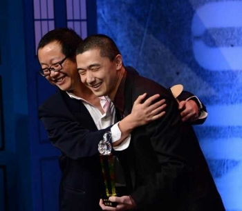Cixin Liu and translator Ken Liu accepting the Chinese Xingyun (Nebula) Award for  The Three-Body Problem  (2014, photo via  Tor.com )