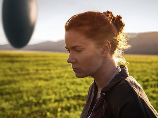 "Amy Adams in  Arrival , the film adaptation of Ted Chiang's ""Story of Your Life."""