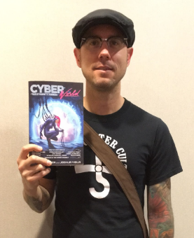 Jason Heller, editor of Cyber World. At MileHiCon, Denver, October 2016. Mugshot by Lisa Mahoney.