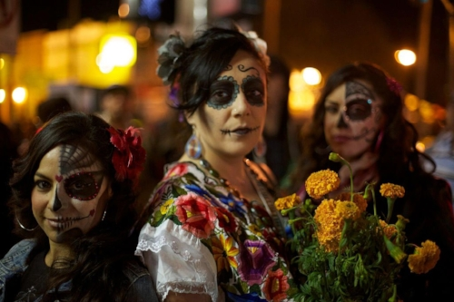 Women with  calaveras  makeup celebrating  Día de Muertos  in   Mission District   of San Francisco, California. Photo:      Jared Zimmerman .