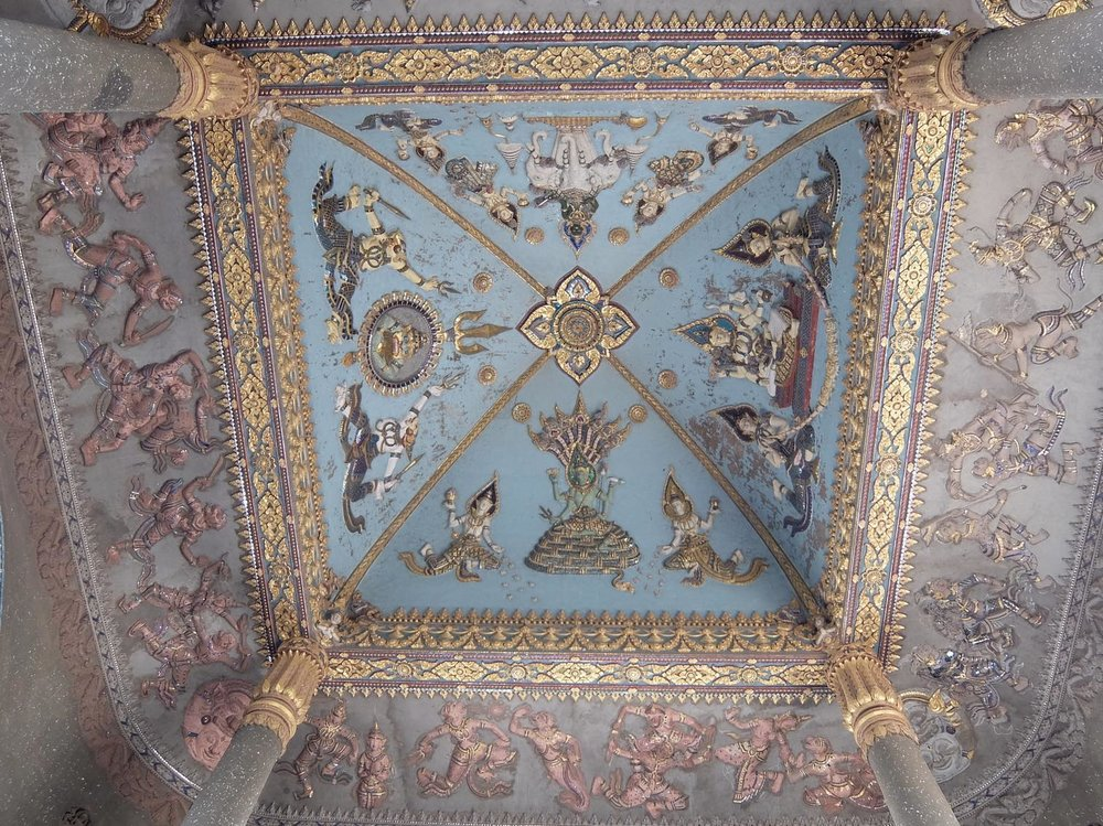 Ceiling of the Lao National Monument ringed with scenes from the Ramayana.