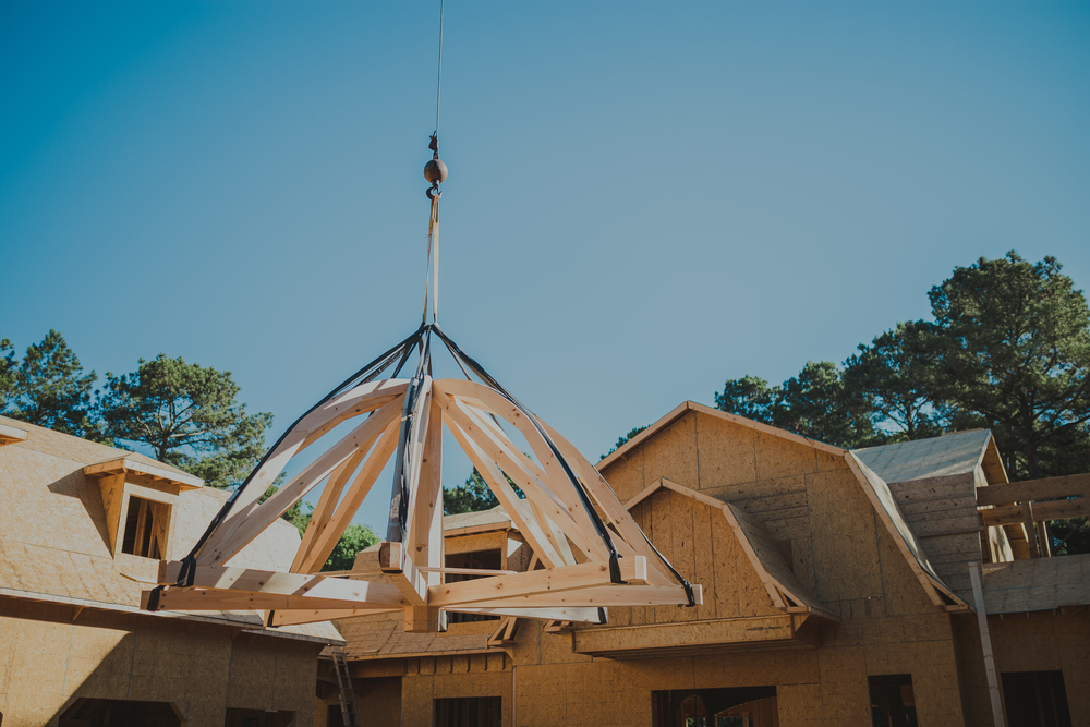 handmade timber frame octagonal roof in white pine uses lots of scarf joints in athens georgia.