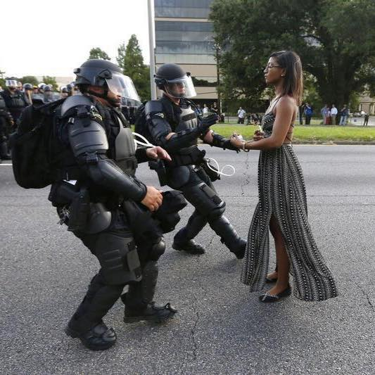 A demonstrator protesting the shooting death of Alton Sterling is detained by law enforcement near the headquarters of the Baton Rouge Police Department in Baton Rouge, La., on July 9, 2016 . Jonathan Bachman—Reuters
