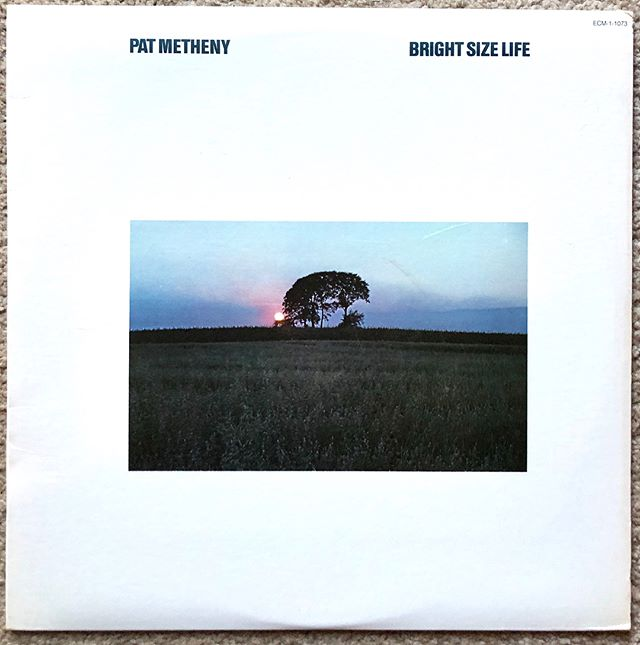 "(3 of 7) Pat Metheny- Bright Size Life (1976)- Greetings from Seattle where it's supposed to reach 83° today and everyone is freaking out. I am @somekindofjohnster aka John Totten and this is my favorite jazz record. Jazz is my first love. My high school jazz band teacher, Mr. Ward, introduced me to this record right before he sent me of to the University of Tennessee to study double/electric bass and major in jazz performance. I was already a Jaco Pastorius fan but had never heard him play in a trio. My mind was appropriately blown by all three players on this album. Pat Metheny was 21 years old when this album came out. Jaco was 25. Drummer Bob Moses was the old man of the group at 28. One of my improvisation teachers at UTK was renowned jazz educator Jerry Coker, who taught both Pat and Jaco at University of Miami in the 70s. His statement about them as young adults- ""There was nothing I could teach them. They already knew everything."" So the University decided to make the kid Metheny their guitar teacher. This album is the young Metheny's tribute to his native Missouri with it's stark ECM-classic artwork and song titles like ""Missouri Uncomprimised"" and ""Midwestern Nights Dream."" Metheny wanted to record a modern (for 1976) jazz record that captured the feel of the Missouri landscape. I played this album for my wife two years ago on our first road trip across America right as we drove from Omaha to Kansas City and I think he accomplished his goal. He also changed the way jazz guitar was played by adding rock ""sus"" chord voicings without losing the bop language. That last pic is the price tag from September 2005 which is the exact month I landed in Seattle. A few months later I was working at Easy Street Records. Hard to find records this clean/good for $4 now, but back then we were still living under the reign of King Compact Disc. Listen to both excerpts from the title track, one of the head and one of the guitar solo. One of the best songs ever written."