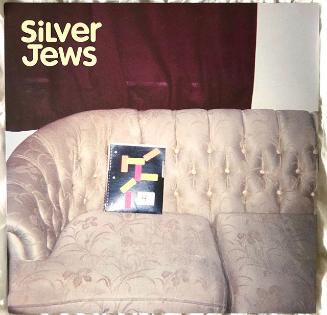 "(7 of 7) Silver Jews- Bright Flight (2001)- I'm bringing it all back home, to my home state and to my favorite record label and to an artist who has sent things to my actual house before. @somekindofjohnster here with my final day of hosting. Posting my favorite album and apparently this accounts second David Berman story. First off about the record- American Water gets all the accolades but Bright Flight is my personal favorite Silver Jews album. I would argue that the best lyric of our generation is ""And I wanna be like water if I can, 'cause water doesn't give a damn."" So simple and yet so meaningful, a truly efficient chorus in ""Horseleg Swastikas."" Here in Seattle we are having an ominous rainy day in August- In 13 years I've never seen it rain here in August. This album fits my ominous climate feelings of weather apocalypse. After, all time *will* break the world. It is a complete album in my opinion right down to the sad closer, ""Death of an Heir of Sorrows."" I sent David Berman a fan letter in 2007 asking him to give me a  title for a @q1music  album. A few months later I got the postcard above. It just said, ""John, better walk than ride like that. Aider uzoi foren iz besser tsu fus gaien, DCB."" So we named our album Better Walk Than Ride Like That. A year or two later I saw Silver Jews at the Showbox in Seattle. I walked up to Berman afterwards and said ""You gave me my most recent album title."" He said ""What did I give you?"" And I said ""Better Walk Than Ride Like That."" He said, ""That's good."" After that I would send him music and ask his advice. He titled the Quiet Ones final record, Molt in Moments, as well. When I started my current band, @daggerhandz - I sent him our record and got back a long academic musing on improving on your heroes by destroying them. But I just can't. Music like this is too good and meaningful to me. I mean, shit, there's a beautiful song about falling in love in Chattanooga. Who hasn't been in that exact position before? I know I have.  It's been my and Brenda's pleasure hosting here this week, feel free to follow me or my projects- @betweenuspod or @daggerhandz -enjoy your summers and take care!"