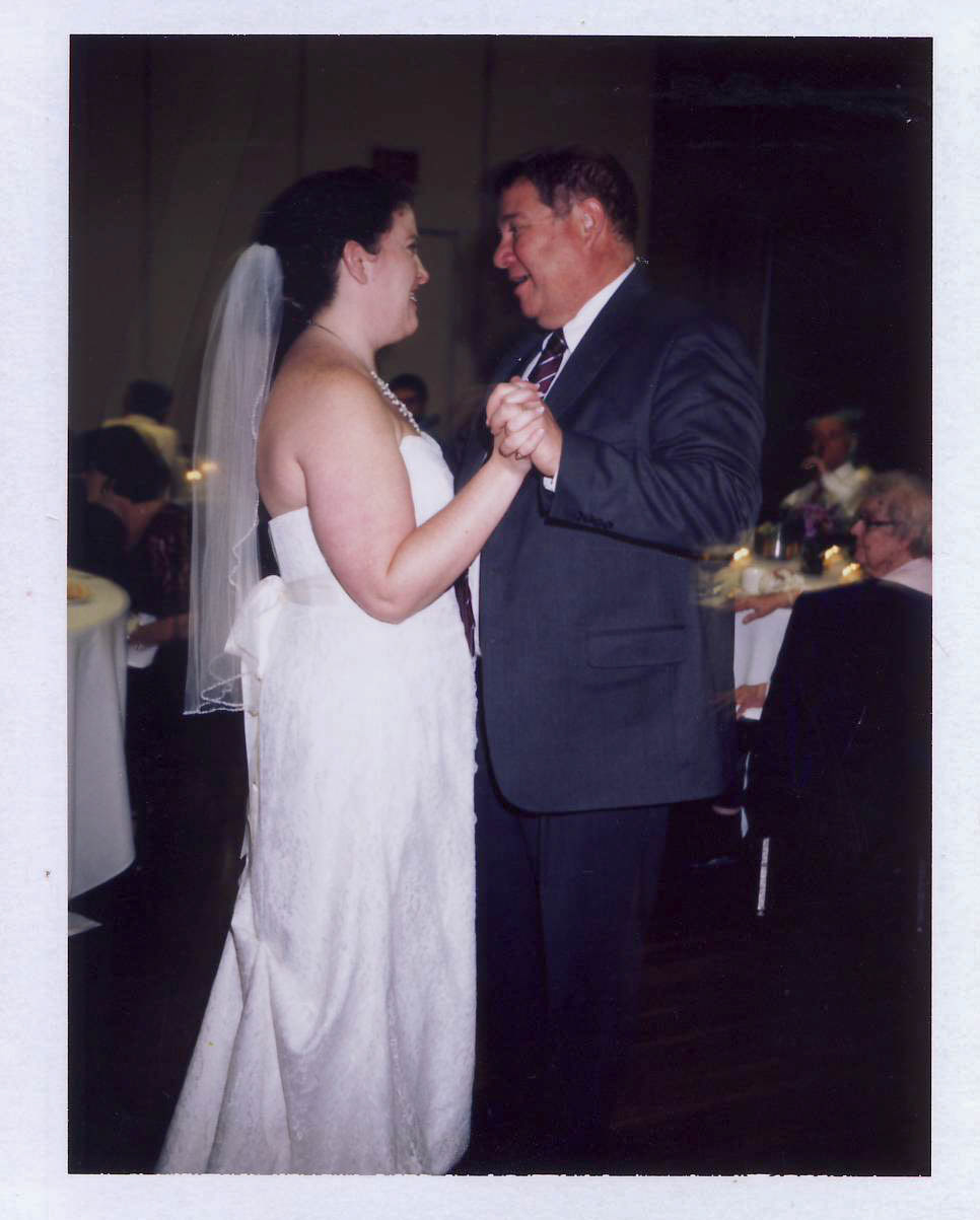 First Dance - This is my favorite photograph! Kim and I decided to keep as much of our wedding in Wausau as low key as possible. However, she did want to celebrate with her father by having a first dance. Together, we created a play list of songs that included a lot of Christmas music. For her first dance, Kim chose
