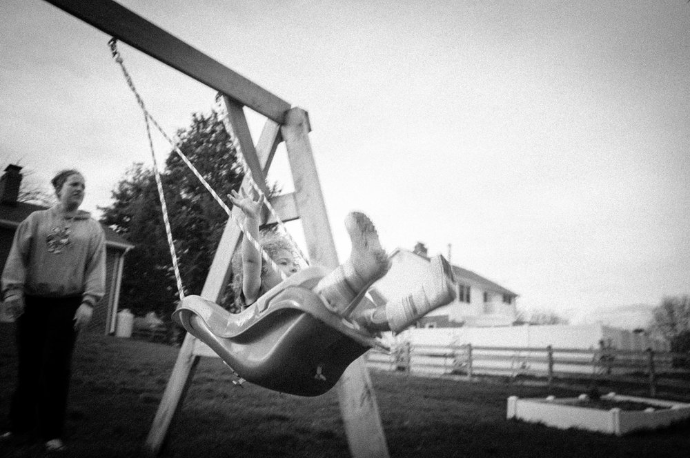 Olive and Mom on Swing BW.jpg