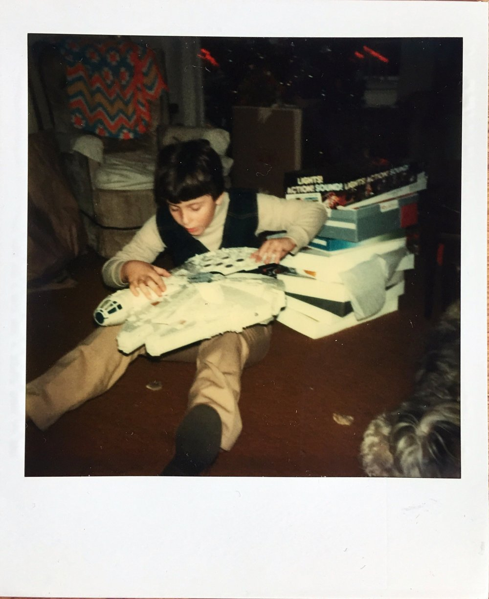 Another favorite of mine, a grandson opening his Christmas present. We've been in touch and I hope to reunite these Polaroids with him and other family members.