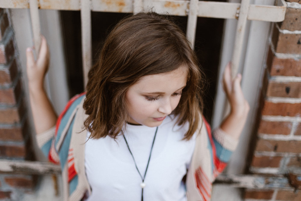 Sometimes the most beautiful tween portraits are when eye contact with the camera is totally avoided. Chris Ginn Photography in Franklinton, Louisiana tween portrait sessions.