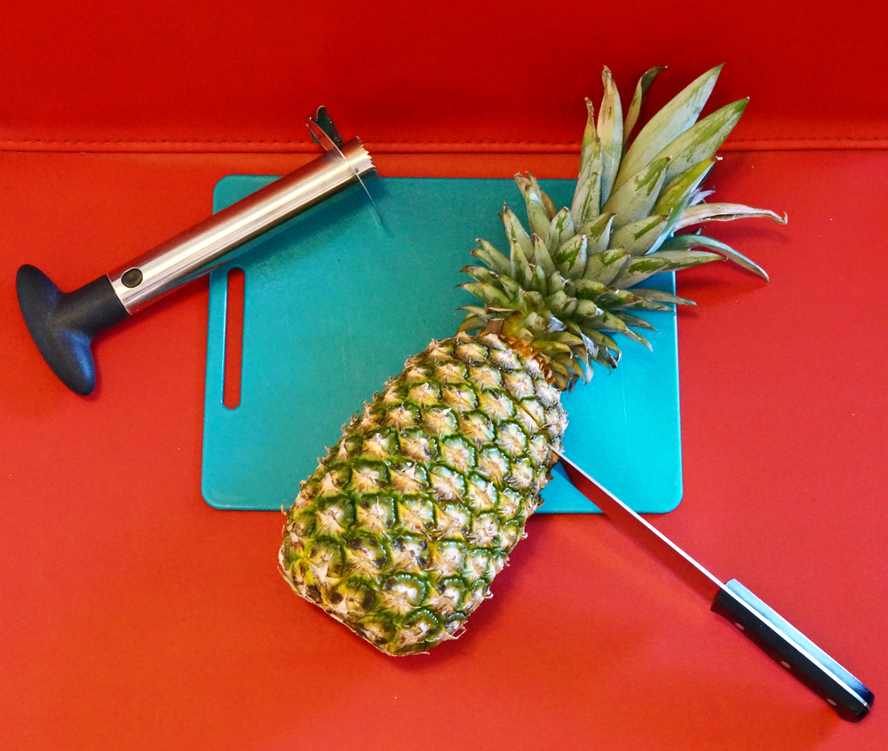 cutting-pineapple-top.jpg