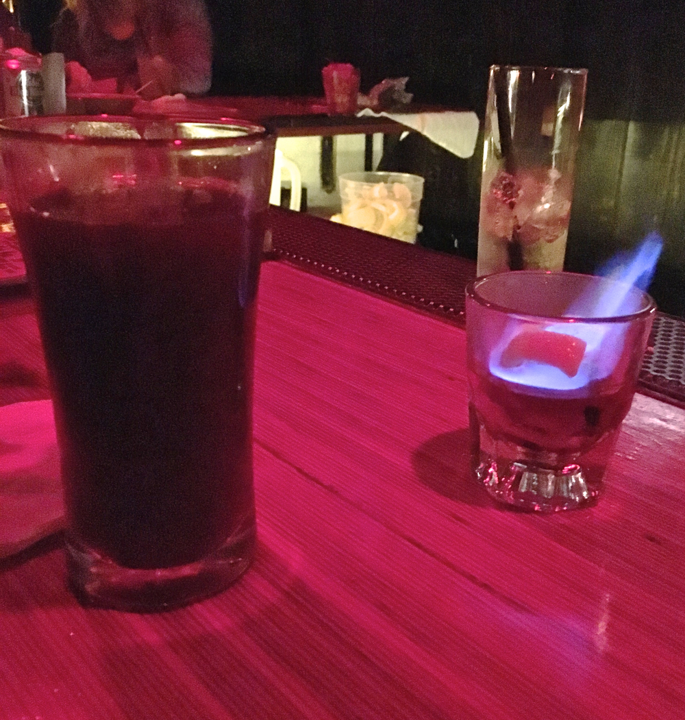 "flaming coffee grog  ""flames down the glass. for the coffee fan. kind of clove and cinnamon with citrus."""