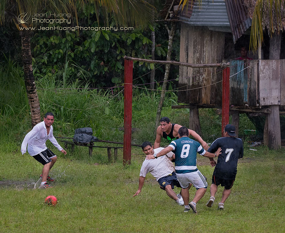 Playing-Soccer-in-Rain-Casual-Amazon-Peru-Copyright-Jean-Huang-Photography