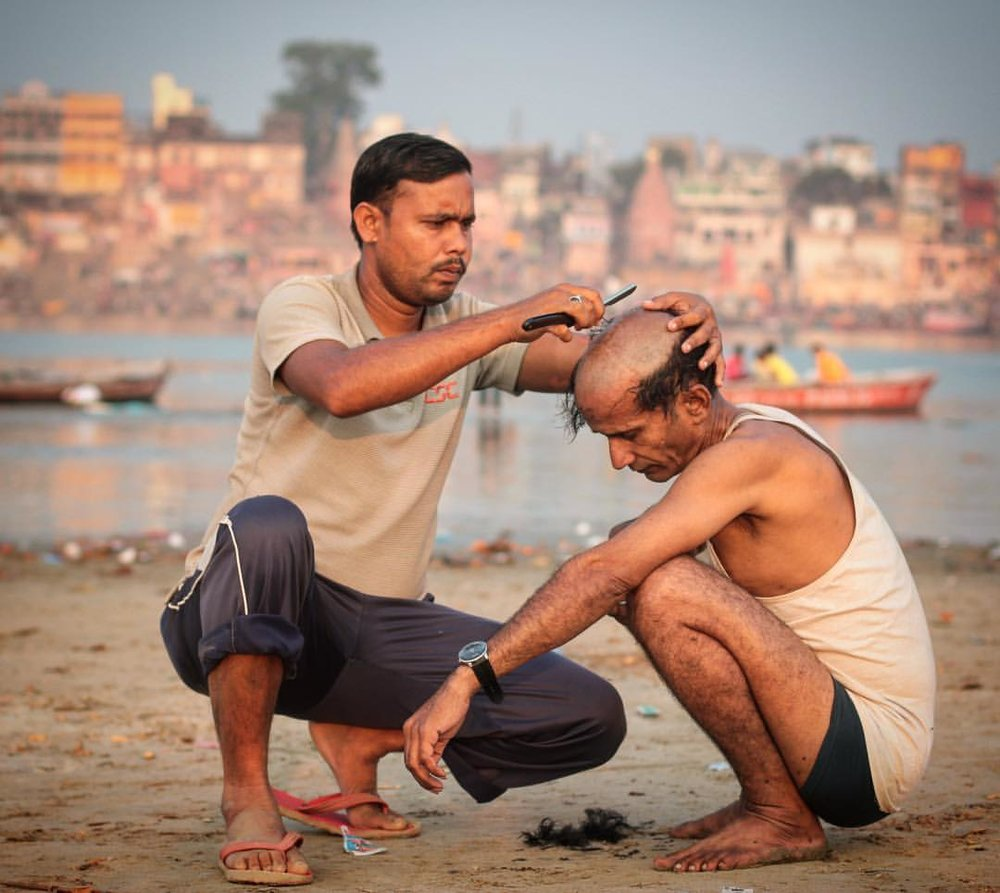 Here only a day and already my hairline is seen as a prestigious status symbol. — in  Varanasi, India .