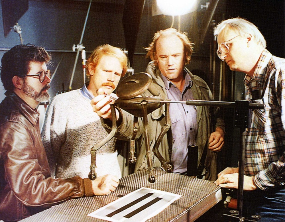 (L-R) George Lucas, Ron Howard, Phil Tippett and Dennis Muren during post-production on  Willow , 1988.