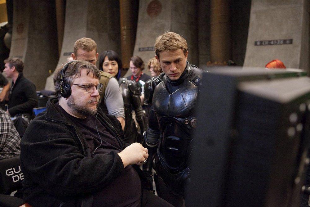 (L-R) Guillermo Del Toro, Rinko Kikuchi and Charlie Hunnam on the set of  Pacific Rim