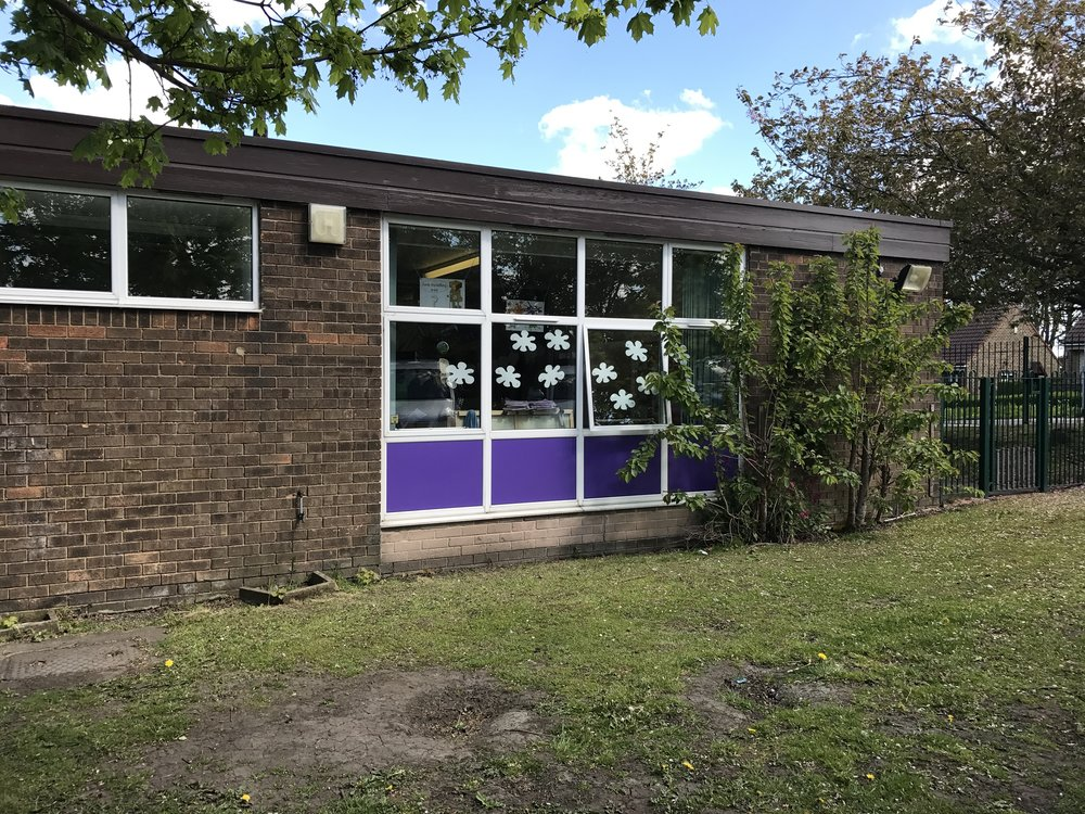 AFTER: The window coverings are now in the school colours