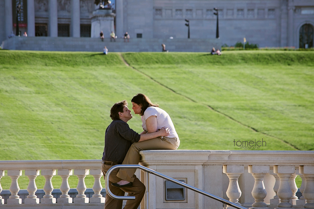 Engaged couple at the bottom of Art Hill in Saint Louis, Missouri. #stlengagement #saintlouisengagementphoto #stlphotographer #tomeichphotographer