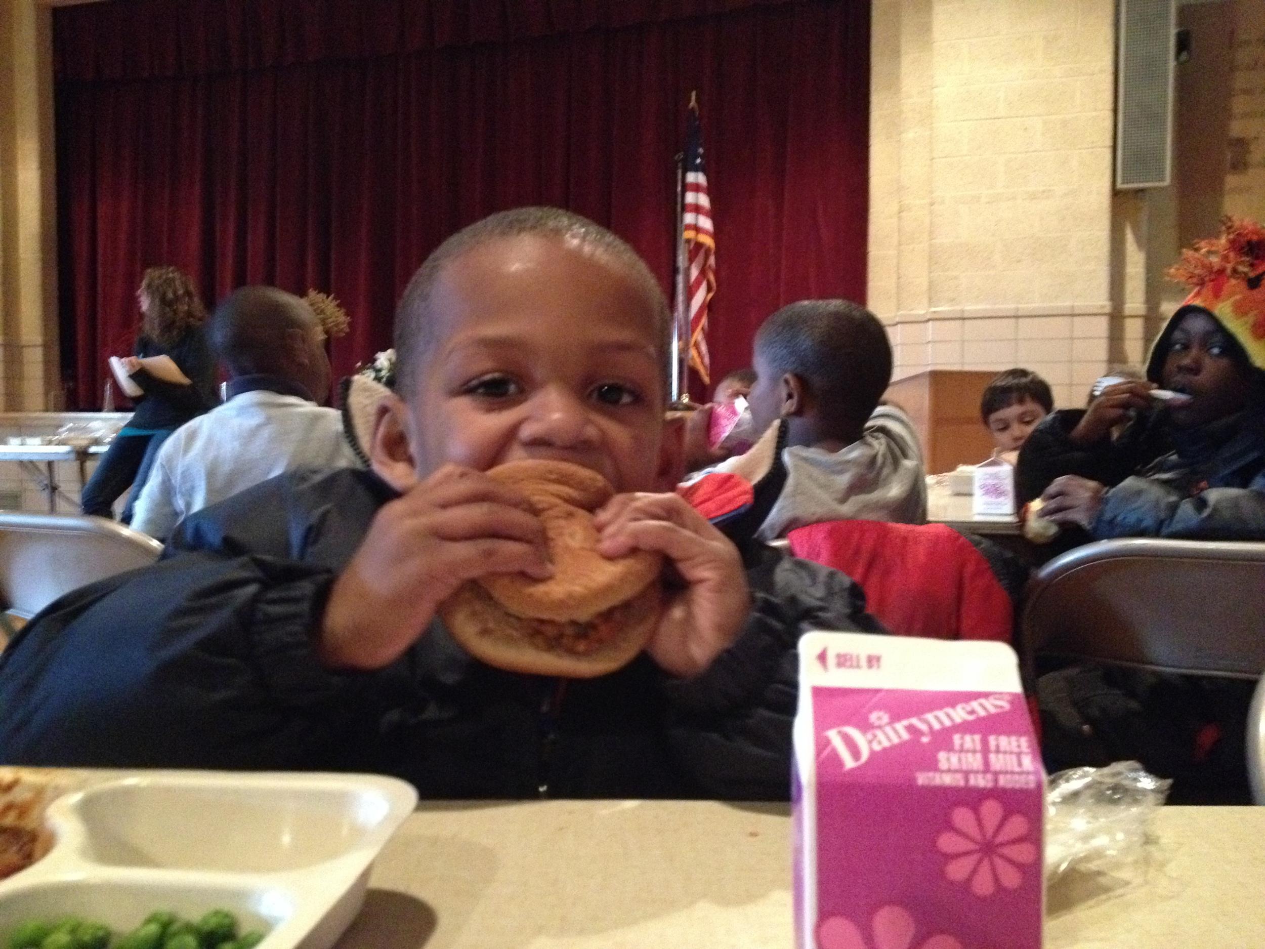 Elijah has a lentil slider for lunch.