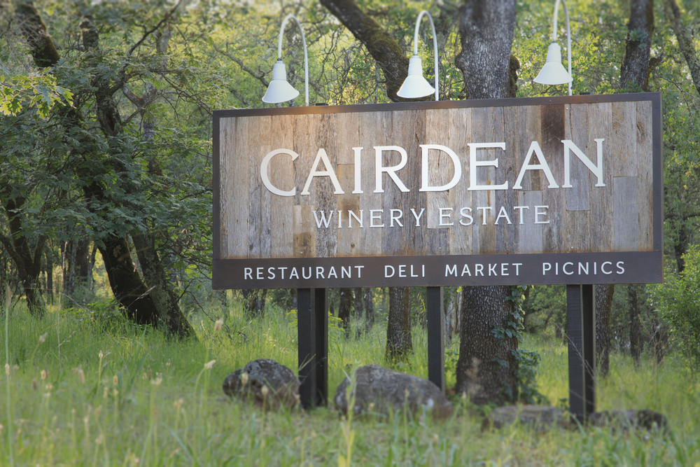 Monument sign design for Cairdean Winery Estate using reclaimed barn wood and steel. Linn Design Studio updated the logo, developed the sign to fit the same size as a previous sign and worked with the sign fabricator.