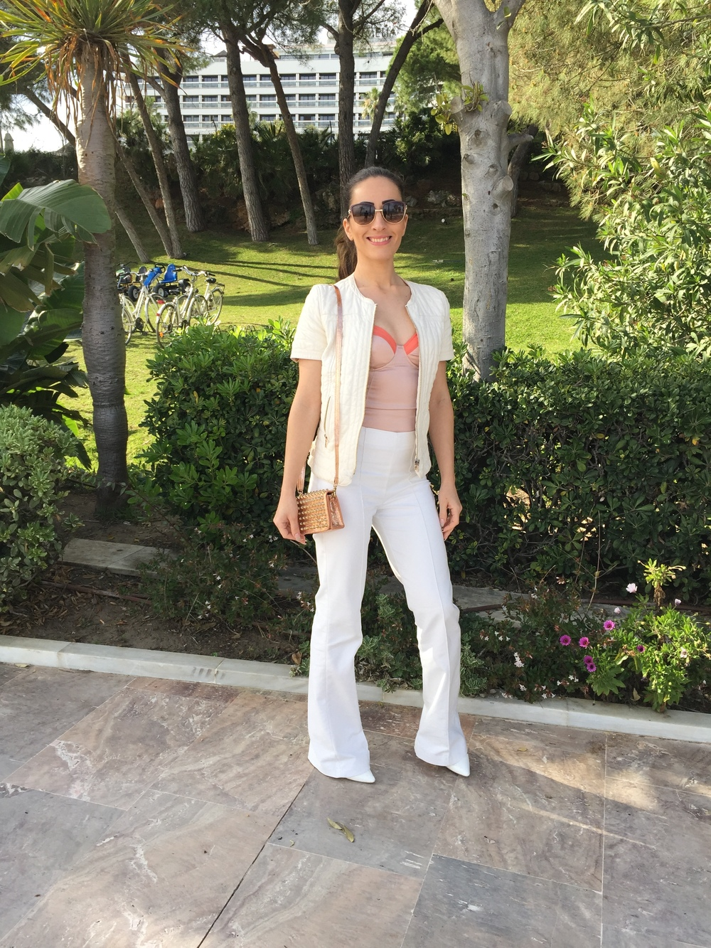 coral-satin-top-white-pants-outfit-marbella