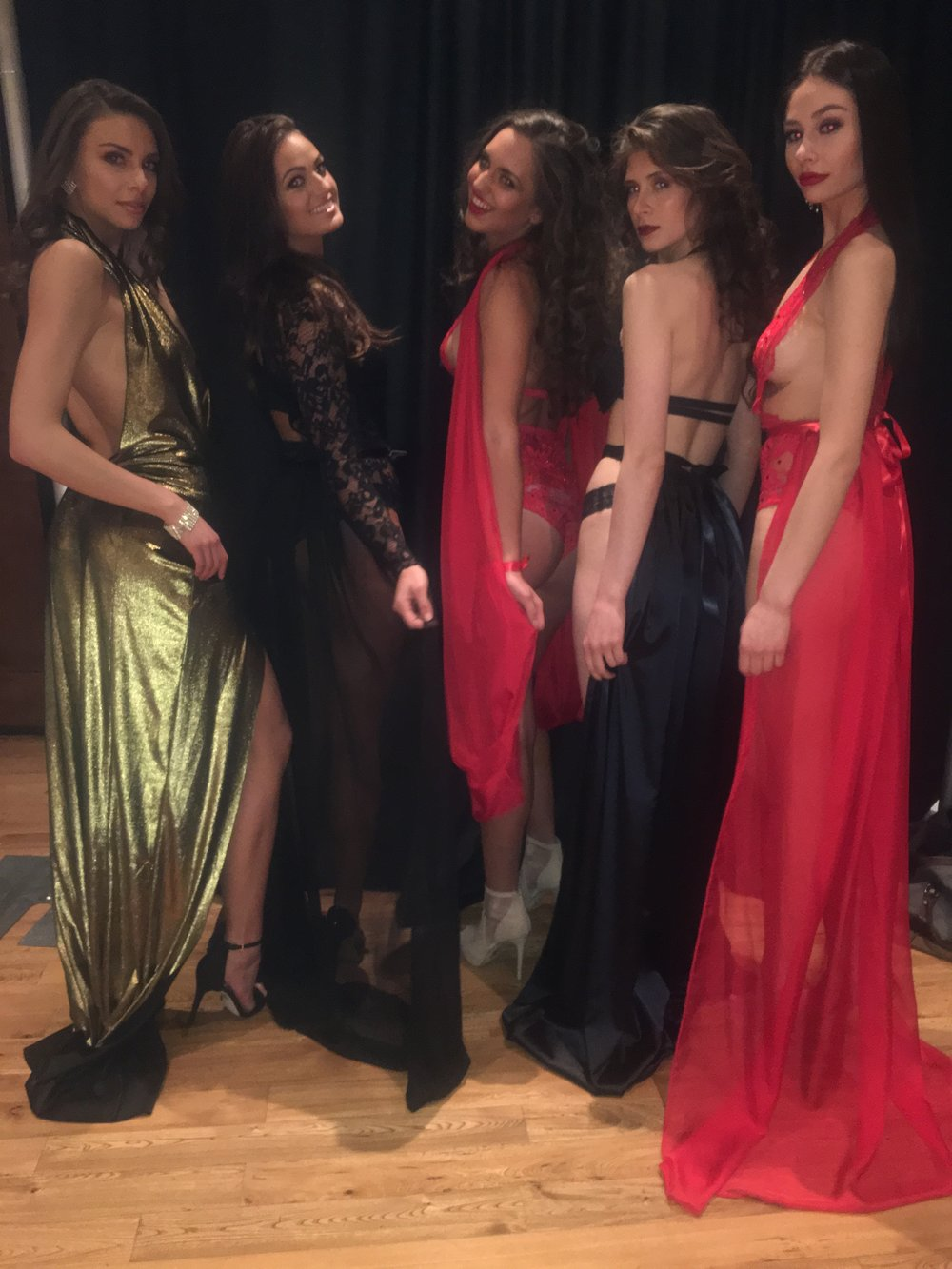 The fabulous models giving one last pose backstage before they walk the runway.