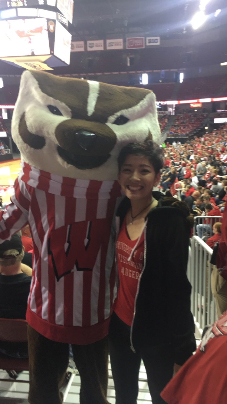 Vanali posing with Bucky Badger at a UW-Madison Badger basketball game.