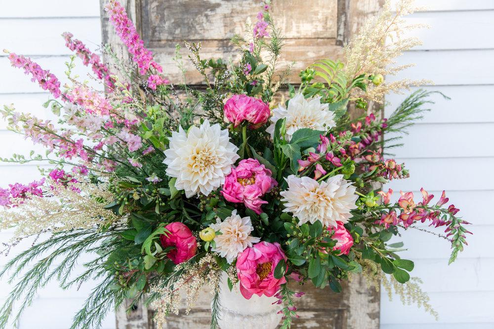 A stunning floral arrangement by La Tulipe.