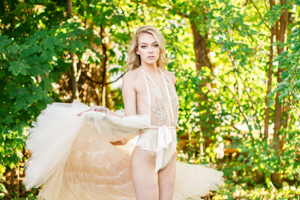 Nicole Petrie twirling in her champagne tulle skirt and hand embellished satin bodysuit.