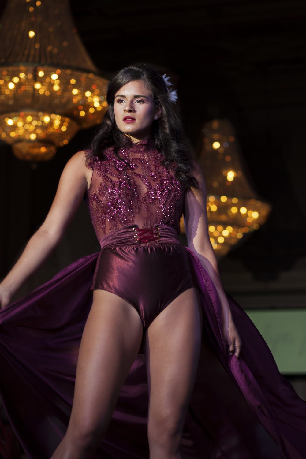 Sonia Weber slays the runway in a daring bordeaux hand appliqued bodysuit and corseted silk habotai skirt.