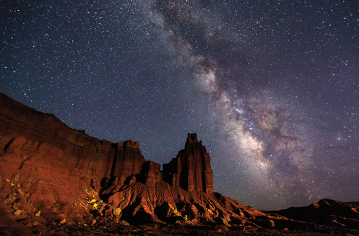 The Milky Way arches over Capitol Reef National Park's iconic Chimney Rock. Photo by Jacob W. Frank.