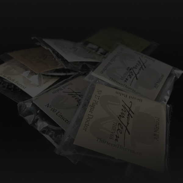 Explore Our Natural Products for Your Extravagant Life - Thirteen Thievessells handmade men's grooming products. Made in Boise ID, we offer organic and natural small batch production of Beard Grooming Products, Facial Serum, Pomade, Beard Oil, Shaving Oil, Hand Poured, Mustache Wax, Beard Balm, Hair Tonic.