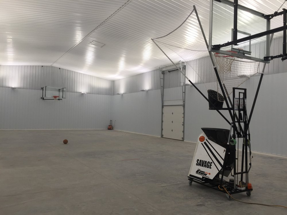 The concrete in our basketball court still needs to cure for a few more weeks before we can install the Dynacourt synthetic sports flooring, but that's not stopping our client from putting in some work on his game.