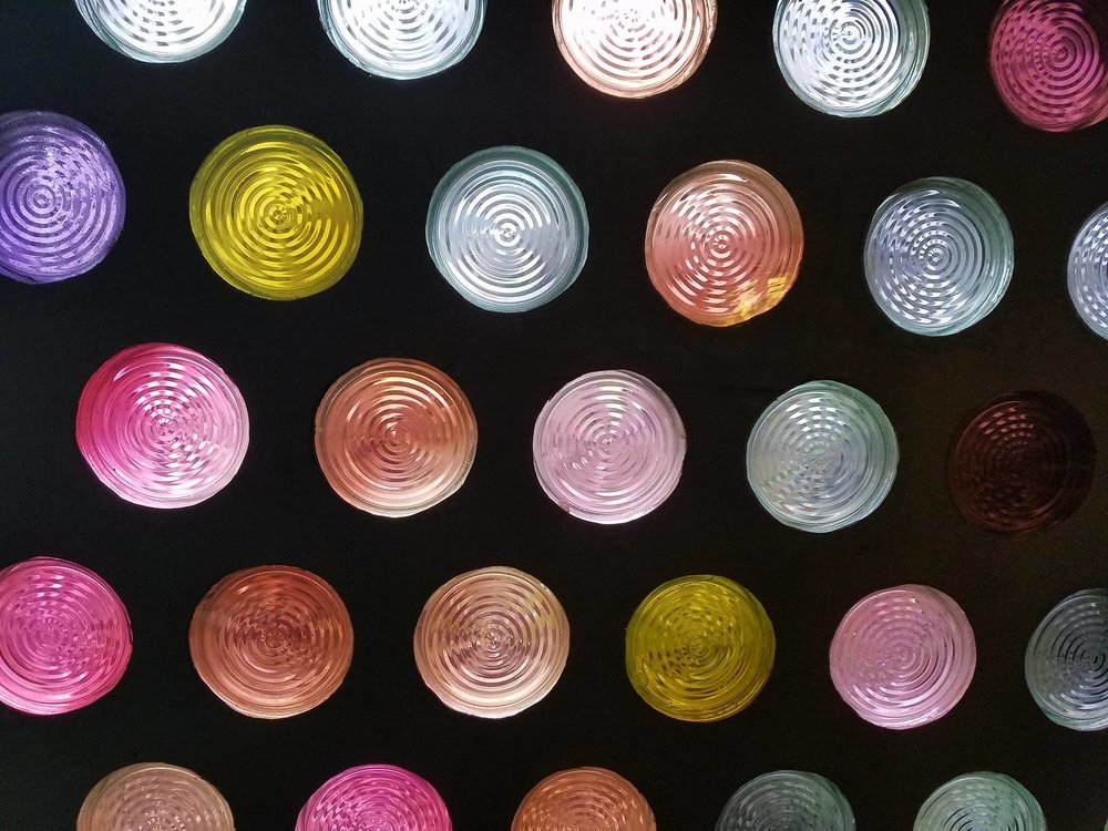 Small, colorful round windows in the Foyer of the Philharmonie