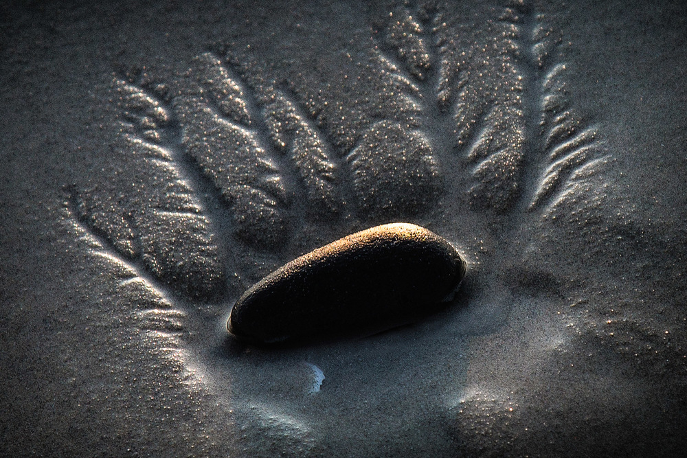 Beach-Stone-In-Sand-Pattern-At-Sunset-Abstract.jpg