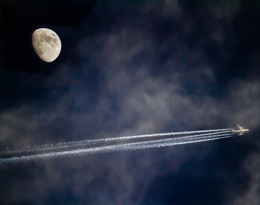 Jet-Leaves-Vapor-Trails-As-It-Flies-By-Moon.jpg