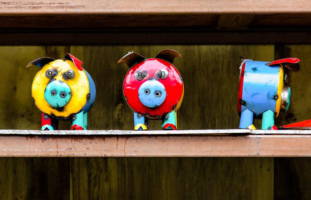 Colorful-Metal-Pig-Sculptures-On-Shelf.jpg