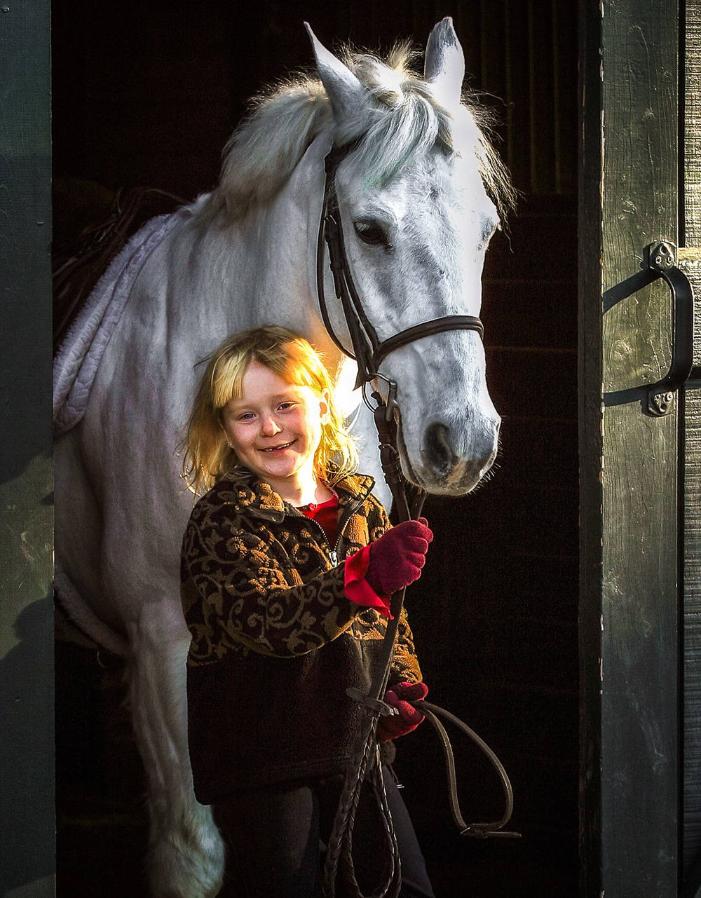 Young-Girl-holds-White-Horse.jpg