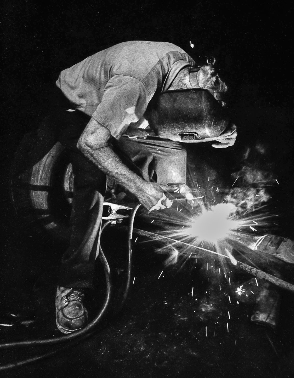 Welder-In-Mask-Welds-Frame-Arc-Light-BW.jpg