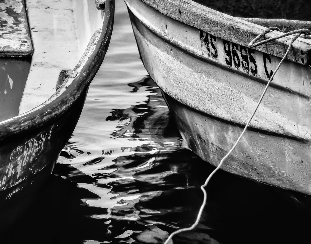 Rowboat-Hulls-And-Tie-Rope-In-Water-BW.jpg