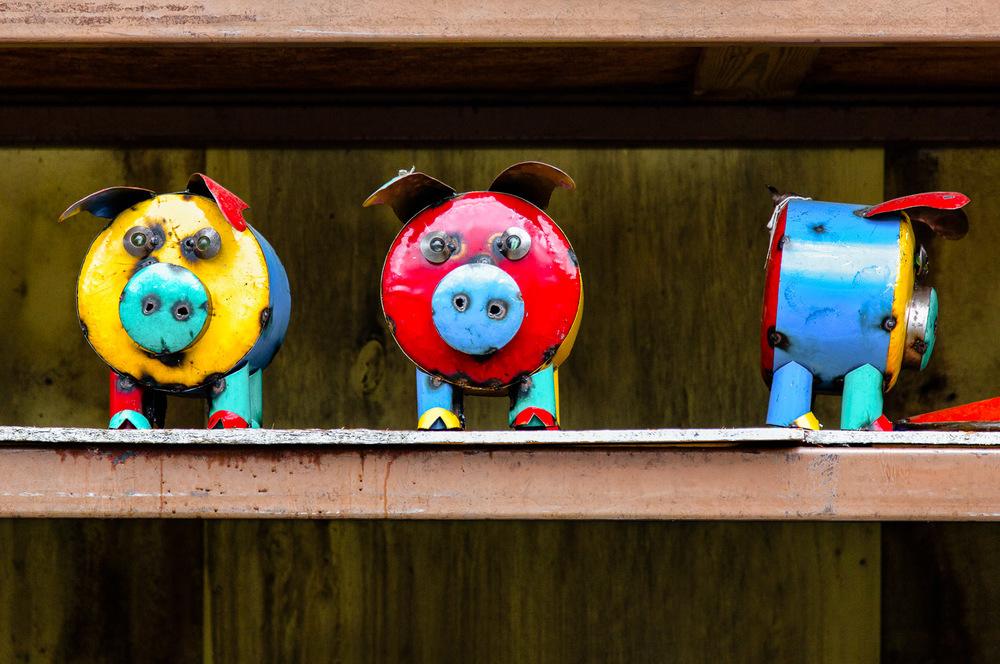 Metal-Pig-Sculptures-Multicolored-On-Shelf.jpg