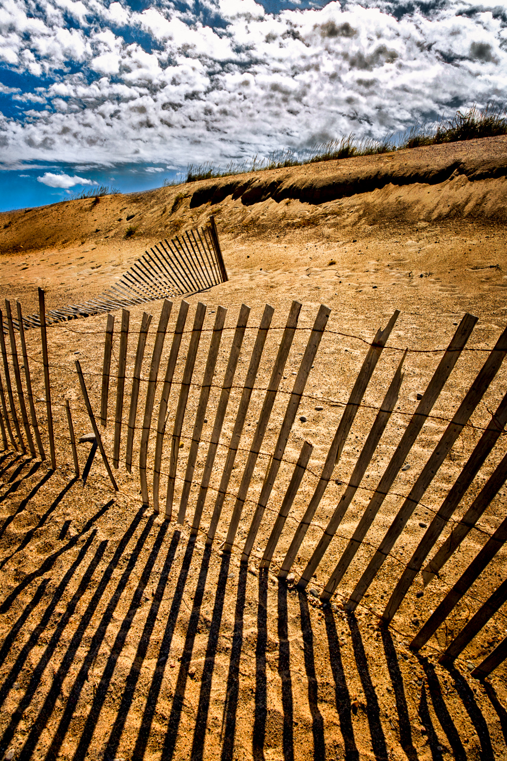 Puffy-Clouds-Over-Old-Sand-Fence-Dune-And-Shadows-2-2.jpg