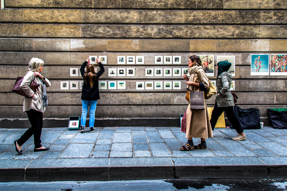 Artist Hangs Works Paris, France