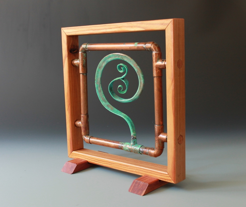 Copper spiral panel with reclaimed wooden frame