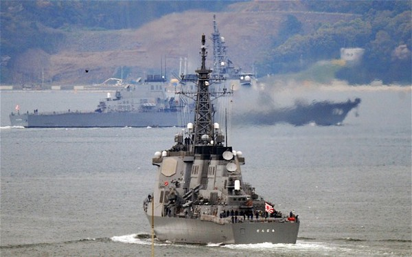 Japanese Maritime Self-Defense Force's Aegis guided-missile destroyers, Kongo (front) and Chokai (rear), leaving their base in Sasebo, Nagasaki Prefecture to head out to sea. (AFP/GETTY)
