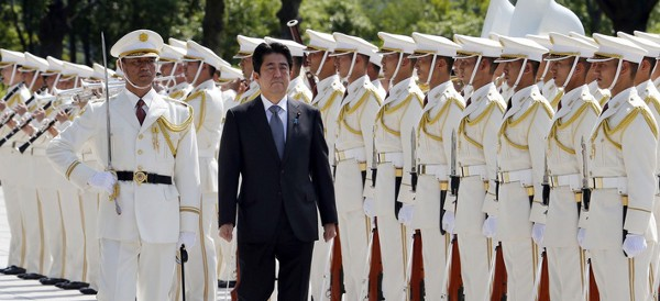Japanese Prime Minister Shinzo Abe reviews an honor guard in a ceremony prior to his meeting with officers of the Japan Self Defense Forces, on Sept. 12, 2013. (Koji Sasahara/AP)