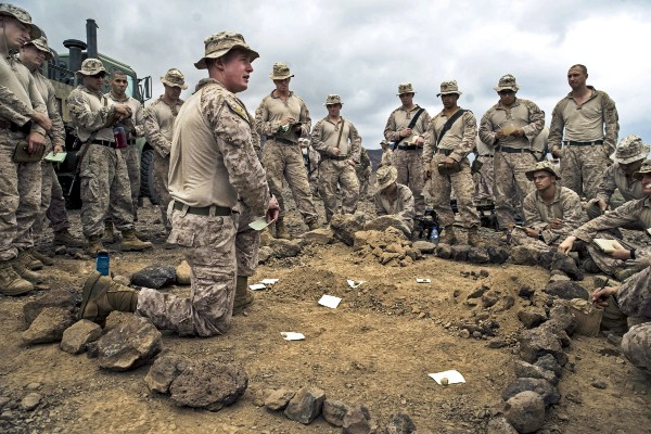 U.S. Marines receive a sand table briefing before a platoon assault exercise on Arta Range, Djibouti, Feb. 10, 2014. (U.S. Air Force photo by Staff Sgt. Erik Cardenas)