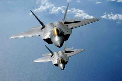 Two  F-22  Raptors fly over the Pacific Ocean. (USAF photo by Master Sgt. Kevin J. Gruenwald)