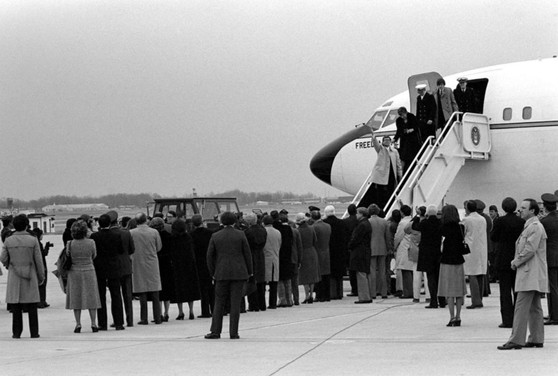 The hostages disembark Freedom One, an Air Force  Boeing C-137 Stratoliner  aircraft, upon their arrival at the base.